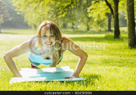 Woman doing pushups in morning park stock photo, Female fitness instructor exercising doing pushups in green summer park by Elena Elisseeva
