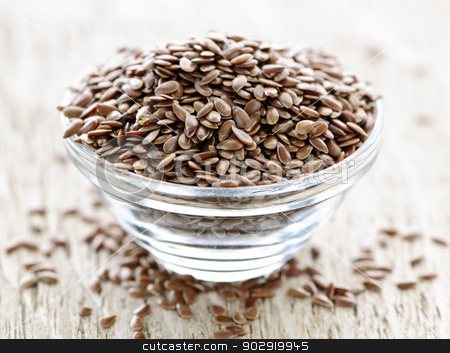 Brown flax seed stock photo, Bowl full of brown flax seed or linseed by Elena Elisseeva