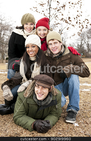 Group of friends outside in winter stock photo, Group of young friends having fun outdoors in winter by Elena Elisseeva
