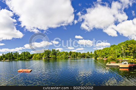 Cottage lake with diving platform and dock stock photo, Beautiful lake with dock and diving platform in Ontario Canada cottage country by Elena Elisseeva
