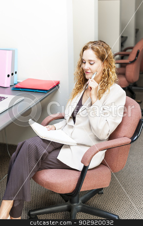 Business woman thinking at office desk stock photo, Businesswoman thinking of ideas in office workstation by Elena Elisseeva