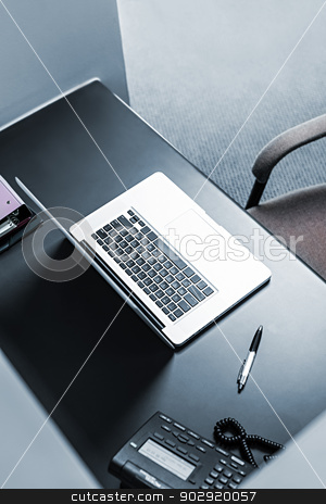 Laptop at office desk stock photo, Office workstation with laptop computer, pen and phone by Elena Elisseeva