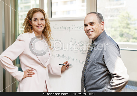 Agent presenting real estate costs stock photo, Real estate agent using flip chart with closing cost data by Elena Elisseeva