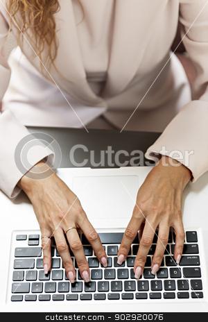 Hands typing on laptop keyboard stock photo, Female hands typing on laptop keyboard from above by Elena Elisseeva