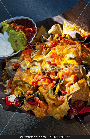 Nacho basket with cheese stock photo, Basket of nachos with cheese jalapeno and toppings by Elena Elisseeva