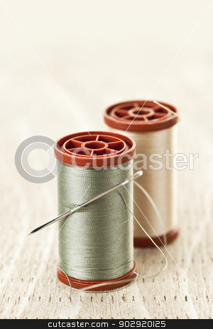 Thread and needle stock photo, Two spools of thread with needle for sewing by Elena Elisseeva