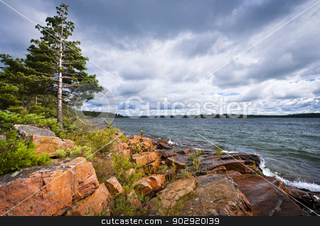 Rocky shore in Georgian Bay stock photo, Rocky lake shore of Georgian Bay in Killbear provincial park near Parry Sound, Ontario, Canada. by Elena Elisseeva