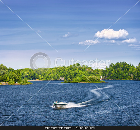 Woman boating on lake stock photo, Woman piloting motorboat on lake in Georgian Bay, Ontario, Canada by Elena Elisseeva