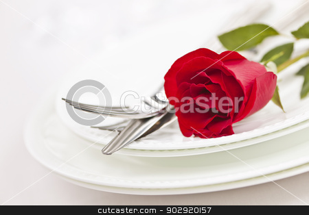 Romantic dinner setting stock photo, Romantic restaurant table setting with red rose on plates by Elena Elisseeva