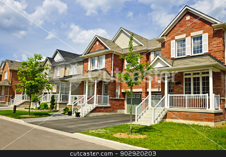 Row of new suburban homes stock photo, Suburban residential street with row of red brick houses by Elena Elisseeva
