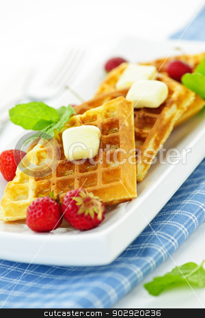 Belgian waffles stock photo, Plate of belgian waffles with fresh strawberries and pats of butter by Elena Elisseeva
