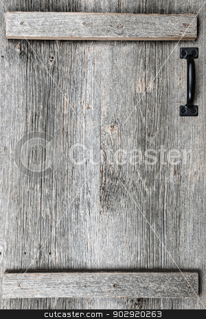 Old barn wood door stock photo, Distressed rustic barn wood door with handle as textured background by Elena Elisseeva