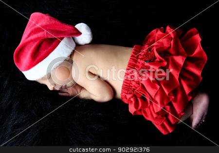 Newborn Christmas stock photo, Newborn baby girl wearing a christmas hat and red frills by Vanessa Van Rensburg