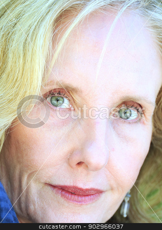 Mature female blond beauty. stock photo, Mature female blond beauty posing outside. by OSCAR Williams
