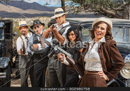 Laughing 1920s Era Gangsters stock photo, Laughing beautiful woman with submachine gun and gangsters by Scott Griessel