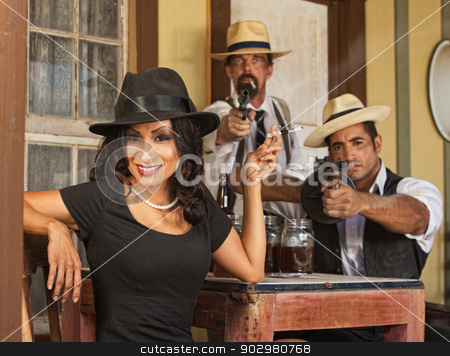 Smiling Woman with Whiskey Bootleggers stock photo, Whiskey bootleggers and beautiful woman pointing guns  by Scott Griessel