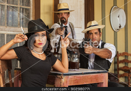 Prohibition Era Gangsters stock photo, Pretty woman gesturing a gun with whiskey bootleggers by Scott Griessel