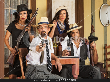 Armed Bootlegger Pointing Gun stock photo, Armed bootlegger in beard with gangsters pointing gun by Scott Griessel