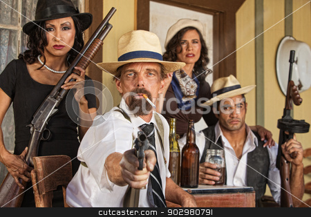 Smoking Gangster with Whiskey and Guns stock photo, Armed smoking gangster with bootleggers pointing his pistol by Scott Griessel