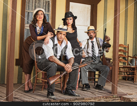 Four Armed Gangsters Sitting stock photo, Group of four criminal gangsters with shotgun and submachine gun by Scott Griessel