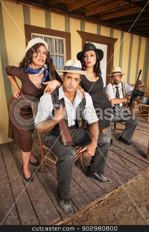 Vintage Gangsters with Guns stock photo, Vintage gang members with weapons and beautiful women by Scott Griessel