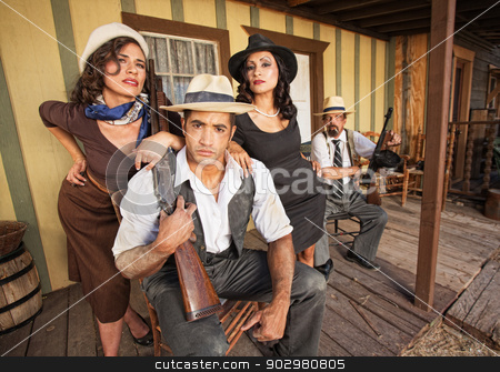 Criminals with Pretty Women stock photo, Two beautiful women with handsome criminals holding guns by Scott Griessel