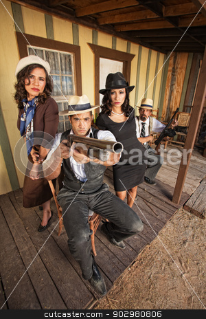 Tough Gangster Aiming Shotgun stock photo, Tough 1920s gangster with pretty woman aiming a shotgun by Scott Griessel