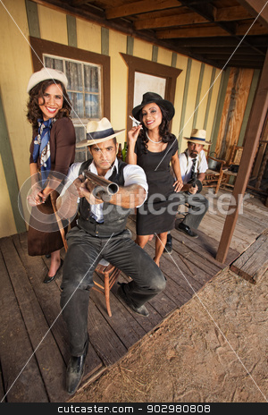 Smiling Women with Armed Gangsters stock photo, Smiling women standing with armed gangsters on porch by Scott Griessel