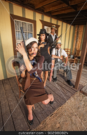 Cigar Smoking Armed Female Gangster stock photo, Cigar smoking female gangster holding a submachine gun by Scott Griessel