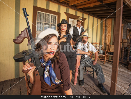 Pretty Woman with Submachine Gun stock photo, Pretty female and handsome male gangsters holding weapons by Scott Griessel