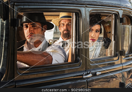 Woman in Car Watching stock photo, Three 1920s vintage gangsters in car watching by Scott Griessel