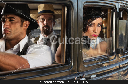 Pretty Woman in Car with Gangsters stock photo, Beautiful 1920s era woman with mob gang in car by Scott Griessel