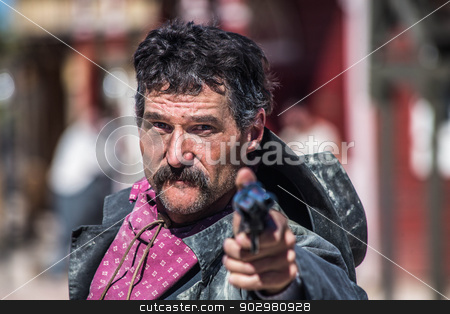 Angry Cowboy With Gun stock photo, a cowboy pointing gun at camera by Scott Griessel