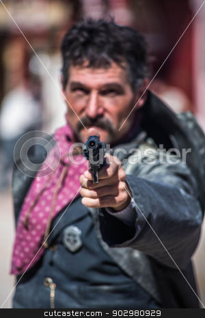 Cowboy Points Gun at You stock photo, Cowboy With One in the Chamber Points Gun at You by Scott Griessel
