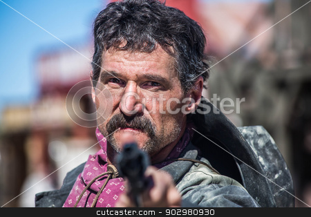 Serious Cowboy With Pistol stock photo, Serious Cowboy Points Gun at You by Scott Griessel