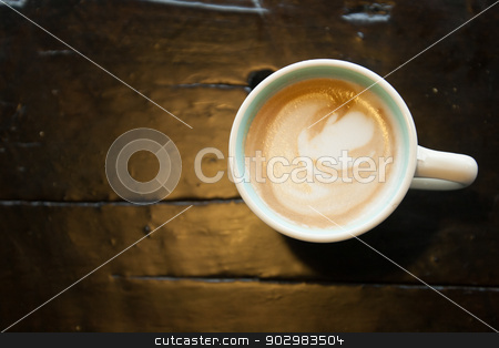 Coffee on wood surface stock photo, Coffee on wood surface by Dave Newman