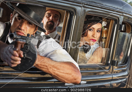 Group of 1920s Armed Gangsters stock photo, Group of three 1920s era gangsters shooting from car window by Scott Griessel