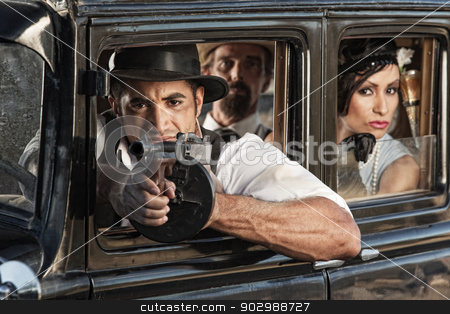 Armed Ganster Shooting from Car stock photo, Armed gangster firing submachine gun from vintage automobile by Scott Griessel