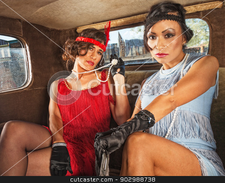 Charming Retro Ladies in Car stock photo, Pair of charming 1920s flappers inside car by Scott Griessel