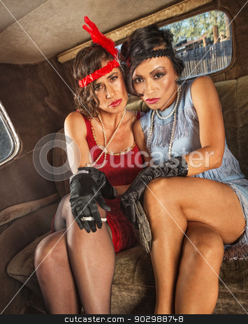 Smoking Flapper Women in Car stock photo, Pair of pretty 1920s flapper women in car by Scott Griessel