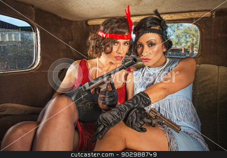 Retro Gangster Females in Car stock photo, Pair of pretty 1920s gangster ladies in car by Scott Griessel