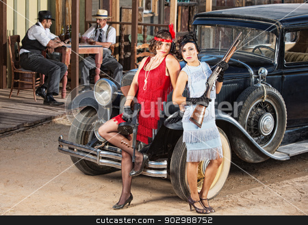 Sensual Female Gangsters stock photo, 1920s vintage gangster women holding weapons near car by Scott Griessel