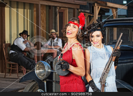 Laughing Female Gangsters stock photo, Pair of laughing 1920s gangster women with guns by Scott Griessel