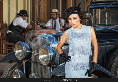 Beautiful Woman in Blue stock photo, Beautiful 1920s female in blue near retro automobile by Scott Griessel