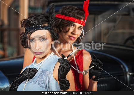 Cute Retro Ladies with Gloves stock photo, Serious Hispanic flapper ladies with pearl necklaces by Scott Griessel
