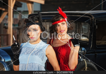 Pretty Flapper Girls stock photo, 1920s flapper girls with cigarette near vintage automobile by Scott Griessel