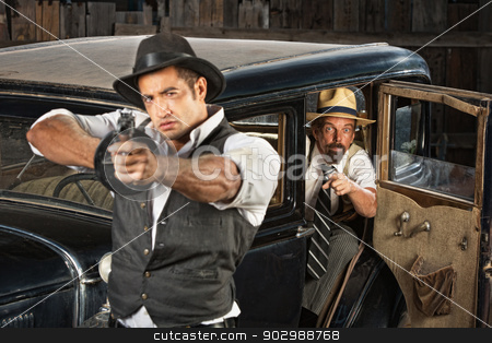 Tough Gangster Aiming Gun stock photo, Tough 1920s vintage gangsters outside aiming guns from car by Scott Griessel