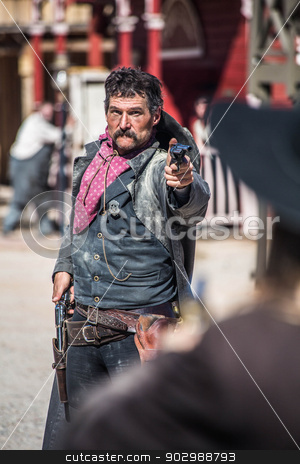 Sheriff Duels Bandit in Town stock photo, Sheriff Points Gun at Outlaw in Town by Scott Griessel