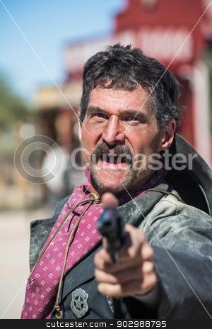 Screaming Cowboy Aims Gun stock photo, Screaming Cowboy Aims Gun at You by Scott Griessel