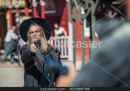 Cowboy Points Gun  stock photo, Cowboy Points Gun at Man in the Middle of Town by Scott Griessel
